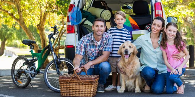 a young family packed up for a road trip